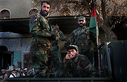 KANDAHAR,AFGHANISTAN - SEPT.6 : Afghan soldiers patrol the city near the Governor's house the day after   an assassination attempt was made on President Hamid Karzai, September 6, 2002 in Kandahar, Afghanistan. Governor Gul Agha Sherzai was shot and wounded, not long after 15 people were killed and many others were wounded in blasts in Kabul.. .(Photo by Ami Vitale/Getty Images)