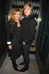 KELLY HOPPEN and NICKY CLARKE at a party to launch the Dom Perignon OEotheque 1995 held at The Landau, Portland Place, London W1 on 26th February 2008.<br />
