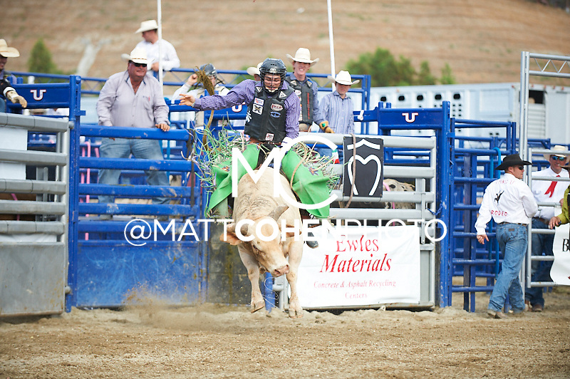 Bull rider Jordan Spears of Redding, CA rides 644/9 French Fries at the Rancho Mission Viejo Rodeo in San Juan Capistrano, CA.  <br /> <br /> <br /> UNEDITED LOW-RES PREVIEW<br /> <br /> <br /> File shown may be an unedited low resolution version used as a proof only. All prints are 100% guaranteed for quality. Sizes 8x10+ come with a version for personal social media. I am currently not selling downloads for commercial/brand use.