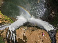 HAWAII - October 15 2016 : Aerial view of a man lying on the top of  Wailua falls in Hawaii, USA.