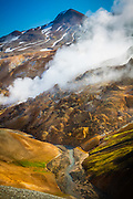 Kerlingarfjöll is a 1,477 m (4,846 ft)) tall mountain range in Iceland situated in the Highlands of Iceland near the Kjölur highland road. They are part of a large tuya volcano system of 100 km2 (39 sq mi). The volcanic origin of these mountains is evidenced by the numerous hot springs and rivulets in the area, as well as red volcanic rhyolite stone the mountains are composed of. Minerals that have emerged from the hot springs also color the ground yellow, red and green.<br /> <br /> The area was formerly known for its summer ski resort, but this was dismantled in 2000. From 2000 Kerlingarfjöll have been operated as a highland resort, offering accommodation and food services to the guests in the area.<br /> <br /> It was on March 17 in 2017 that the Iceland Monitor wrote that Kerlingarfjöll Mountains and geothermal area were being turned into a nature reserve. Although parts of the place already had protection, after made into reserve, all the whole 367 square kilometres are to be under the protection of the state of Iceland. Earlier, there had been thoughts of using the 140 degree Celsius hot springs as a geothermal power plant. It had already been popular of course with hiking and the tourists[