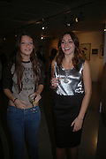 Eliza Warwick and Victoria Hatcher, Silent auction reception in aid of the Aids charity  Clothesline.  The Hospital. London. 19  September 2005. ONE TIME USE ONLY - DO NOT ARCHIVE © Copyright Photograph by Dafydd Jones 66 Stockwell Park Rd. London SW9 0DA Tel 020 7733 0108 www.dafjones.com