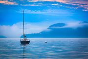 Sailboat off the shore of Orcas Island in the San Juan Islands in Washington state