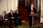 President Bill Clinton makes a statement as PLO leader Yasser Arafat, Israeli Prime Minister Benjamin Netanyahu and King Hussein of Jordan look on at a White House news conference October 2, 1996 In Washington, DC.