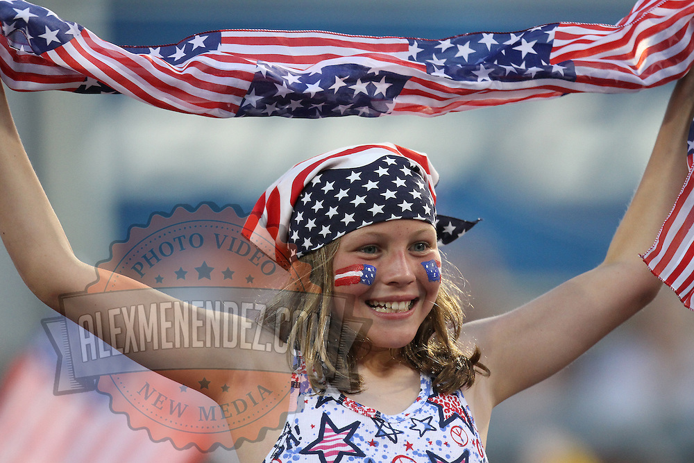 A young fan watches the action during an international friendly soccer match between Scotland and the United States at EverBank Field on Saturday, May 26, 2012 in Jacksonville, Florida.  The United States won the match 5-1 in front of 44,000 fans. (AP Photo/Alex Menendez)