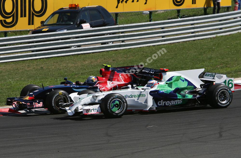 Sebastian Vettel (Toro Rosso-Ferrari) and Jenson Button in a close fight in the 2008 Hungarian Grand Prix at the Hungaroring outside Budapest. Photo: Grand Prix Photo