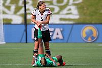 Fotball<br /> VM kvinner<br /> 07.06.2015<br /> Tyskland v Elfenbenskysten<br /> Foto: imago/Digitalsport<br /> NORWAY ONLY<br /> <br /> Fair play, Annike Krahn (Deutschland) leistet nach dem Schlusspfiff Erste Hilfe bei Ines Nrehy (CIV), die einen Krampf hat
