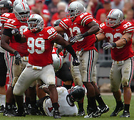 MORNING JOURNAL/DAVID RICHARD.Jay Richardson, front left, and the Ohio State defense celebrate after stopping Northern Illinois' Garrett Wolfe for a loss yesterday in Columbus.