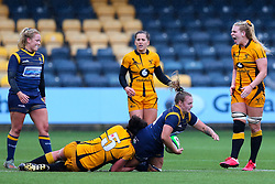 Taz Bricknell of Worcester Warriors Women is brought to ground by Rowena Burnfield of Wasps FC Ladies - Mandatory by-line: Nick Browning/JMP - 24/10/2020 - RUGBY - Sixways Stadium - Worcester, England - Worcester Warriors Women v Wasps FC Ladies - Allianz Premier 15s