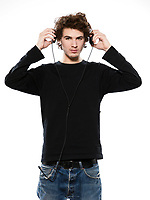 studio portrait of a caucasian young man listening to music on white background