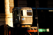 "A train in the Chicago rapid transit system known as the""L"" arrives in a station in the LOOP in Chicago, IL, USA."