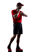 one young man runner jogger taking heartbeat pulse in silhouette isolated on white background