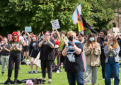 "© Licensed to London News Pictures; 18/07/2020; Bristol, UK. A Trans Rights protest rally takes place on College Green. Speakers include Shon Faye - writer, presenter, editor, artist, comedian and activist<br /> - Travis Alabanza - artist, performer, writer and theatre maker. The protest is one of many taking place across the UK today and is in protest against reported plans by the UK Government to drop reforms to the Gender Recognition Act and to introduce a law that will restrict the rights of trans women to use women's facilities, such as public toilets, changing rooms and refuges. Proposals to reform the Gender Recognition Act (GRA) would allow people to change their legal gender by ""self-identifying"" as male or female and would let transgender people change their birth certificate without a medical diagnosis. But the Government looks set to drop these, despite 70 per cent of responses to a recent consultation of the GRA being in favour of self-identification.<br /> Campaigner say the UK Government intends to scrap the GRA reform and roll back the hard-won rights of trans and non-binary people. The Government is also allegedly planning to introduce a law that will restrict the rights of trans women to use women's facilities, such as public toilets, changing rooms and refuges. The event is calling for trans people to be able live their lives without being subjected to discrimination and abuse. Photo credit: Simon Chapman/LNP."