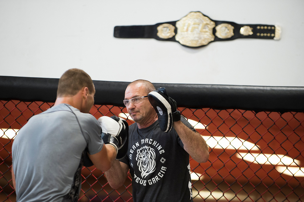 Coach Mike Winkeljohn works with Bellator middleweight Ben Reiter at Jackson Wink MMA in Albuquerque, New Mexico on June 10, 2016.
