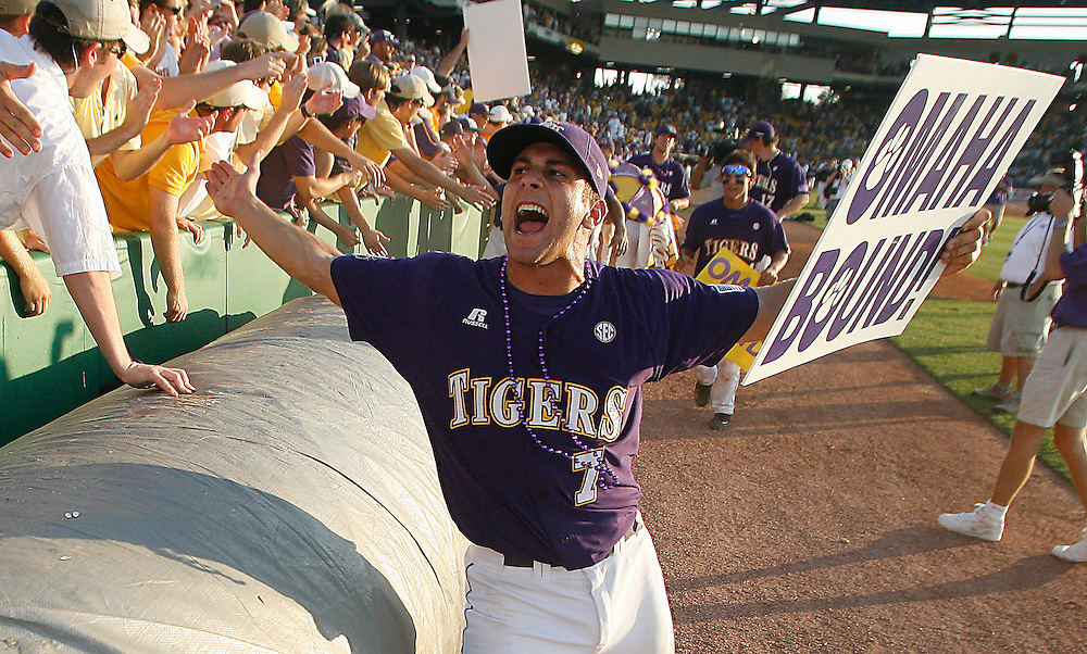June 6, 2009; Baton Rouge, LA, USA; LSU Tigers infielder Grant Dozar (7) celebrates with fans in right field following the Tigers 5-3 victory against the Rice Owls during game two of the Super Regional at Alex Box Stadium in Baton Rouge. Mandatory Credit: Crystal LoGiudice-US PRESSWIRE .