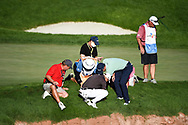 Colin Morikawa (CAN) and Justin Thomas (USA) looking for his ball on the fringe of 18 during the final round at the CJ CUP, Shadow Creek, Las Vegas, Nevada, USA. 18/10/2020.<br /> Picture Ken Murray / Golffile.ie<br /> <br /> All photo usage must carry mandatory copyright credit (© Golffile | Ken Murray)