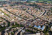 Nederland, Zuid-Holland, Leiden, 15-07-2012; Overzicht binnenstad Leiden In de voorgrond  Museum Volkenkunde (re ) en molen De Valk.  In het midden brug naar de  Turfmarkt en naar links water van Oude Vest en Oude Singel. Boven het midden  Galgewater (re) overgaand in Apothekersdijk en Stille Rijn.Overview old town of Leiden. ethnology museum (bottom right), old mill de Valk (Falcon)..luchtfoto (toeslag), aerial photo (additional fee required).foto/photo Siebe Swart