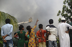 September 10, 2016 - Dhaka, Dhaka, Bangladesh - Rescue worker work at fire site in Tongi industrial area where a boiler exploded and triggered a fire at a packaging factory, killed 26 people near Dhaka. (Credit Image: © Md. Mehedi Hasan/Pacific Press via ZUMA Wire)