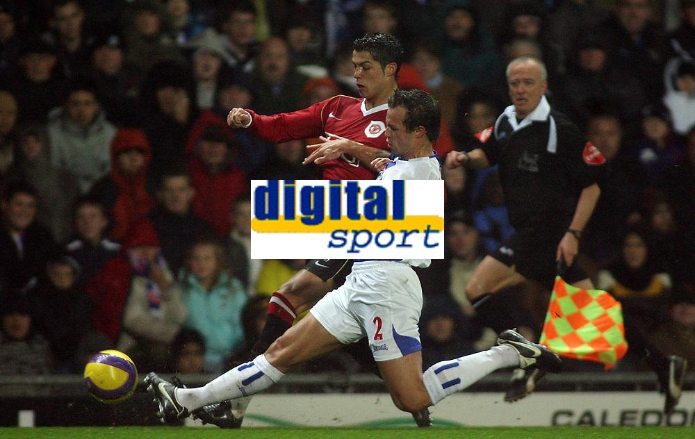 Photo: Paul Thomas.<br /> Blackburn Rovers v Manchester United. The Barclays Premiership. 11/11/2006.<br /> <br /> Blackburn's Lucas Neill (R) tackles Cristiano Ronaldo.