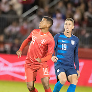 EAST HARTFORD, CONNECTICUT- October 16th:   Andy Polo #14 of Peru defended by Ben Sweat #19 of the United States during the United States Vs Peru International Friendly soccer match at Pratt & Whitney Stadium, Rentschler Field on October 16th 2018 in East Hartford, Connecticut. (Photo by Tim Clayton/Corbis via Getty Images)