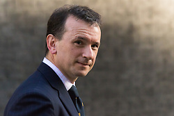 Downing Street, London, March 31st 2016. Welsh Secretary Alun Cairns leaves Downing Street following an emergency meeting of senior government officials to discuss strategies aimed at saving the British steel industry following Tata Steel's decision to close the loss-making Port Talbot steel plant at Downing Street, London. ©Paul Davey<br /> FOR LICENCING CONTACT: Paul Davey +44 (0) 7966 016 296 paul@pauldaveycreative.co.uk