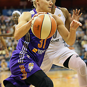 Erin Phillips, Phoenix Mercury, drives past Alex Bentley, Connecticut Sun, during the Connecticut Sun Vs Phoenix Mercury WNBA regular season game at Mohegan Sun Arena, Uncasville, Connecticut, USA. 23rd May 2014. Photo Tim Clayton