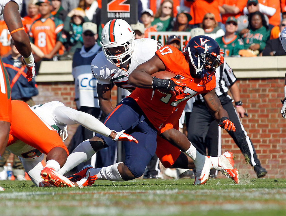 Virginia Cavaliers wide receiver Miles Gooch (17) scores a touchdown next to Miami Hurricanes linebacker Jimmy Gaines (59) during the game at Scott Stadium in Charlottesville, VA. Virginia won 41-40.