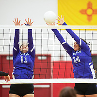 Matejka Abeita, left, and Mariah Livingston with a block for the Miyamura Lady Patriots in their match against the Grants Lady Pirates Tuesday, Sept. 25, 2018 at Grants High School.