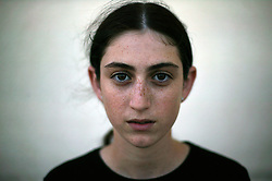 "Rachel Gross, 14, a resident of the Gush Katif settlements, is seen in Gaza, Palestinian Territories, Nov. 4, 2004.  When asked her thoughts about leaving the settlements she responded, ""I want to stay here. I love this place very much. If someone has a problem, everyone helps. Happiness, sadness, we are together."" Israel's parliament recently supported compensation payments for Jewish settlers leaving the Gaza Strip, in a vital vote for Prime Minister Ariel Sharon's plan to evacuate the occupied territory."
