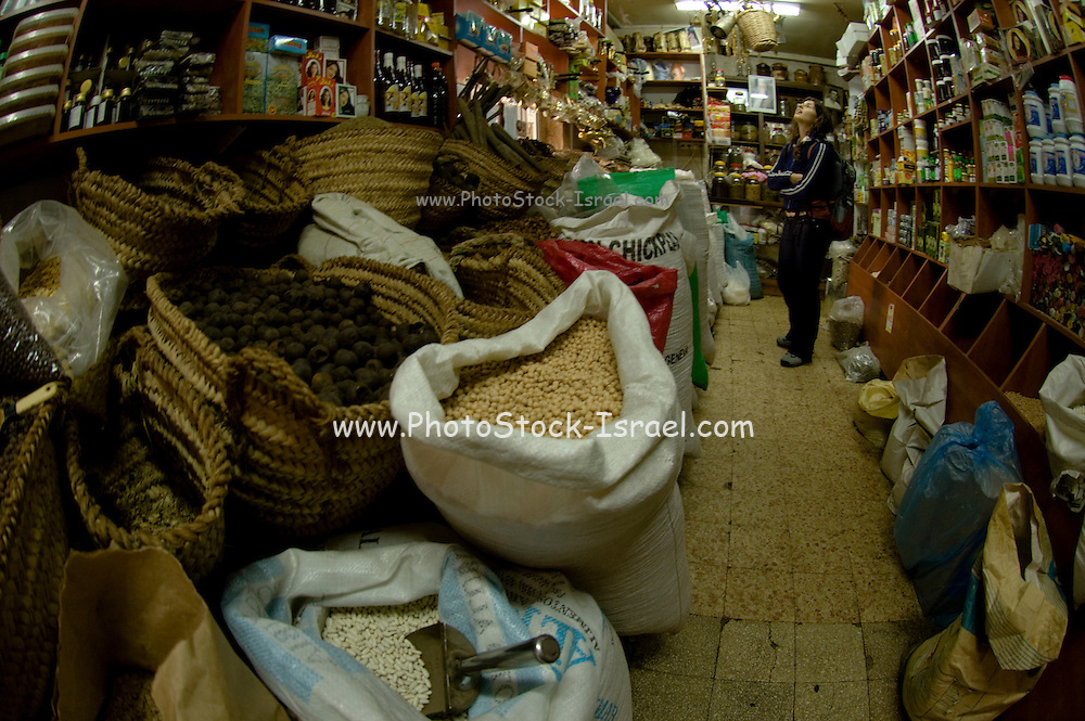 Israel, western Galilee, Acre, the market in the narrow alleyway of the old city. Herb and spice shop - Model Release available