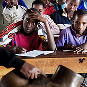 A teacher uses a model of the female genitalia to explain the procedure of FGM to the young students, some of them who will soon be facing their own rite of passage in a rural school  in the Loita Hills in Kenya, a programme set up by the local charity S.A.F.E.<br /> It is mainly Maasais who live in the Loita Hills up above the Serengeti plains.