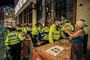 Police arrested Extinction Rebellion activists occupying McDonald's in Leicester Square in central London on Tuesday, Aug 24, 2021.  XR is in an ongoing two-week protest campaign to demand that the government take greater action to address climate change. (VX Photo/ Vudi Xhymshiti)