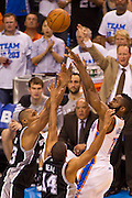 June 2, 2012; Oklahoma City, OK, USA; Oklahoma City Thunder guard James Harden (13) takes a shot over San Antonio Spurs center Boris Diaw (33) and guard Gary Neal (14) during a playoff game  at Chesapeake Energy Arena.  Thunder defeated the Spurs 109-103 Mandatory Credit: Beth Hall-US PRESSWIRE