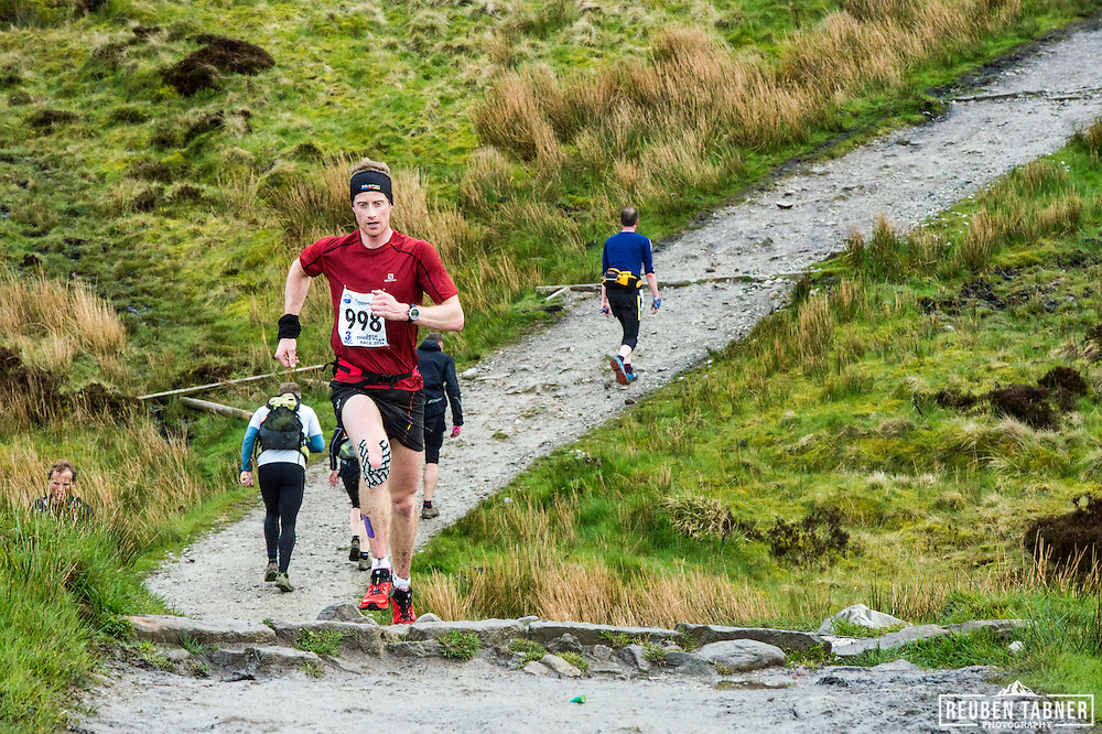 Ricky Lightfoot makes his way back down Pen-y-ghent in the Yorkshire Dales as other runners are still on their way up during the 60th Yorkshire Three Peaks Race.