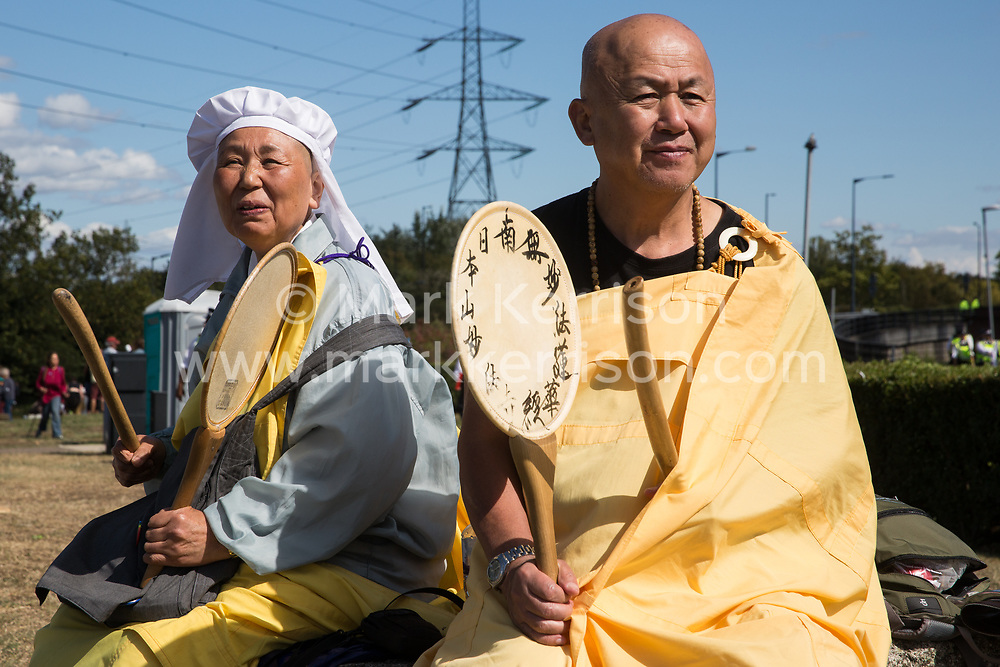 London, UK. 4 September, 2019. Reverend Gyoro Nagase (r) of the London Peace Pagoda joins anti-nuclear activists protesting outside ExCel London on the third day of a week-long carnival of resistance against DSEI, the world's largest arms fair. The third day's protests were organised by the Campaign for Nuclear Disarmament (CND) and Trident Ploughshares.