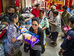 September 4, 2017 - Bangkok, Bangkok, Thailand - People pick up sacks of rice and bottles of cooking oil at Chaomae Thapthim Shrine. About 1,000 people came to the shrine for the annual food distribution. Staples, like rice and cooking oil, are donated to the shrine throughout the year and donated to poor people from the communities around the shrine. Food distributions like this are a tradition at Chinese shrines in Bangkok and a common way of making merit for the people who donate the staples. (Credit Image: © Sean Edison via ZUMA Wire)