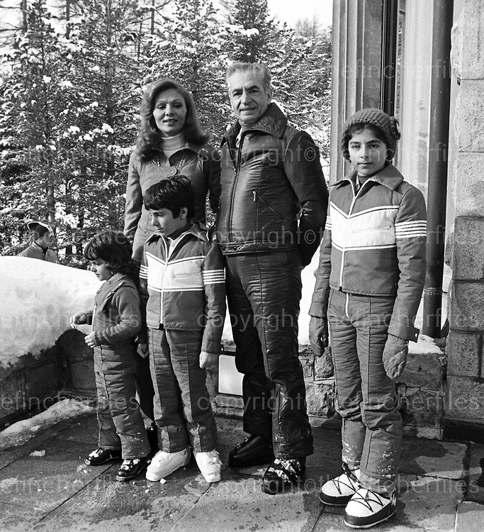 Shah Mohammed Reza  Pahlavi, Shah of Pershia and Iran with his wife  Empress Farah Diba and three of their children. Leila Pahlavi aged 5, Ali Reza Pahlavi aged 9 and Farahnaz Pahlavi aged 12. They are seen on a ski holiday in St. Moritz, Switzerland in January 1975. Photograph by Terry Fincher