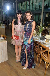 Left to right, MELISSA HEMSLEY and JASMINE HEMSLEY at The Women for Women International & De Beers Summer Evening held at The Royal Opera House, Covent Garden, London on 23rd June 2014.