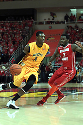 22 January 2014: Cleanthony Early works inward guarded by Daishon Knight during an NCAA Missouri Valley Conference mens basketball game between the Shockers of Wichita Stat and the Illinois State Redbirds  in Redbird Arena, Normal IL.