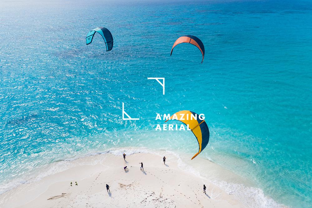 Vashafaru, Maldives - 02 April 2021: Aerial view of a group of kiteboarders, Vashafaru, Maldives.