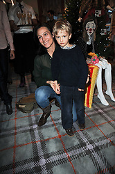 DALIT NUTTALL and her son JAMES at the Juicy Couture children's tea party in aid of Mothers 4 Children held at the Juicy Couture Store, Bruton Street, London on2nd December 2009.