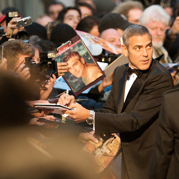 Actor George Clooney signs autographs for fans upon arriving for the world premiere of 'Fantastic Mr. Fox,' on Wednesday night, October 13, 2009, at the Odeon, Leicester Square in London. Director Wes Anderson's film adaptation of the Roald Dahl classic children's story, opened the 53rd BFI London Film Festival.