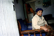 "Francis, 76 years old, a woman living since 40 years in the impoverished area of Heideveld, Cape Town, RSA. She thinks the situation is getting slowly better in the area compared with the lawlessness experienced during the 1980s. Her grandson, who was part of a gang in the area has been shot three times in front of her house by the common drive-by-shootings carried on by rival gangs in the neighbouring areas. She is scared to walk to the shops in Heideveld because she could find herself in the middle of a gunfight on the streets, but she also acquired some confidence after the government decided to build a large police station just on the area's outskirts. She laments the increasing problems due to drug dealing and abuse amongst the youngs and, like most of the people I spoke to, the soaring rate of unemployment. ""If the government helps us with jobs then the situation would b better"" she believes. The US style 'war on gangs' protracted since a few years by the government of South Africa is not showing its fruits; on the contrary, critics has been made to it for the excessive penalties suffered by alleged gang members that overburden an already instable prison system, whether in many advocate a better development and education policy and programmes, rather that an open fight, clarly ineffectual on the long-term. In the mainly 'coloured' area of  Heideveld, where unemployment is rife, gangs are flourishing."