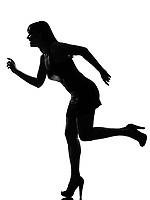 stylish silhouette caucasian beautiful woman running happy  full length on studio isolated white background