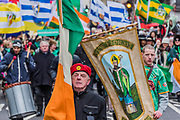 Religion and banners -  the London St Patrick's Day parade from Piccadilly to Trafalgar Square.