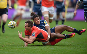 Saracens full-back Andrew Fenby off-loads as he is tackled by Sale Sharks wing Paolo Odogwu during the Aviva Premiership match Sale Sharks -V- Saracens at The AJ Bell Stadium, Salford, Greater Manchester, England on November  20  2016. (Steve Flynn/IOS via AP)