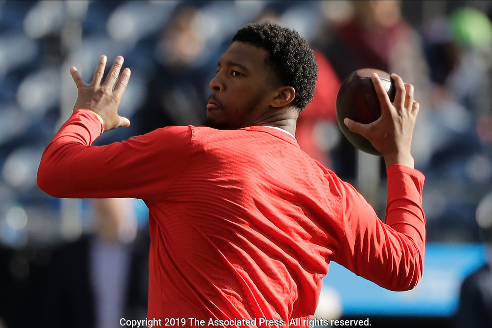 Tampa Bay Buccaneers quarterback Jameis Winston passes during warmups before an NFL football game against the Tampa Bay Buccaneers, Sunday, Nov. 3, 2019, in Seattle. (AP Photo/John Froschauer)