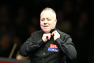 John Higgins of Scotland has trouble with his neck tie during his 1st round match against Sam Baird of England . Coral Welsh Open Snooker 2017, day 1 at the Motorpoint Arena in Cardiff, South Wales on Monday 13th February 2017.<br /> pic by Andrew Orchard, Andrew Orchard sports photography.