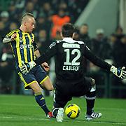 Fenerbahce's Mirosloav Stoch (L) during their Turkish soccer super league match Bursaspor between Fenerbahce at Ataturk Stadium in Bursa Turkey on Monday, 12 December 2010. Photo by TURKPIX