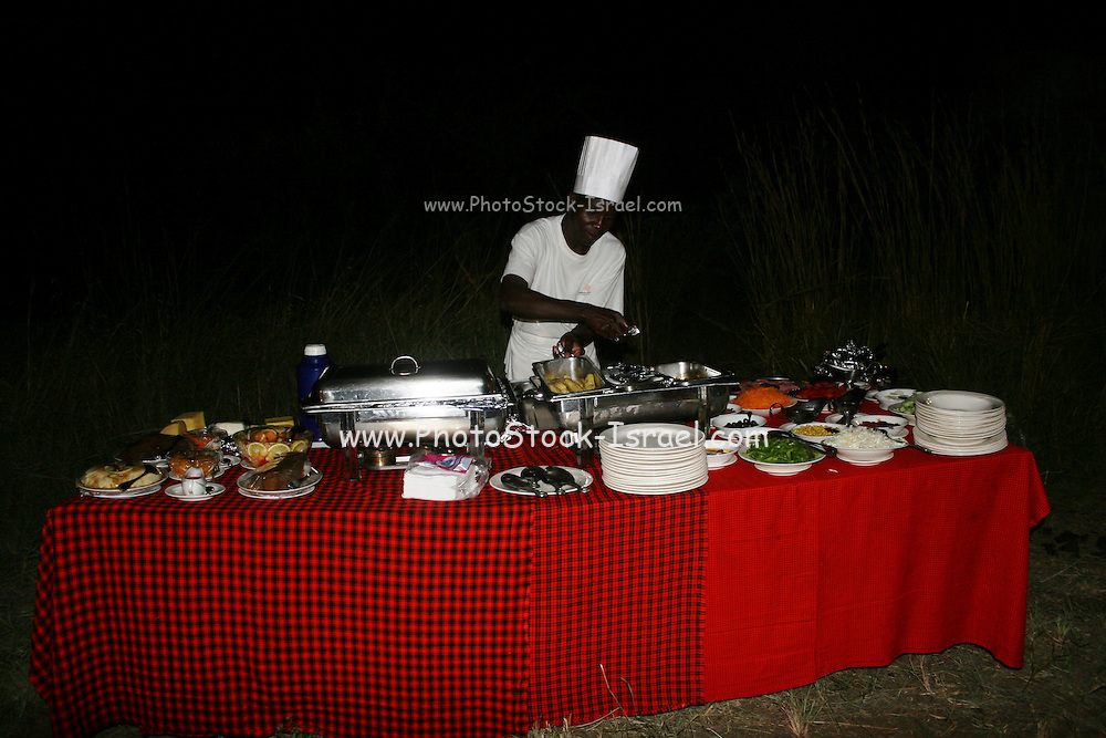 Africa, Tanzania, Serengeti National Park Outdoor dinner at the lodge The local chef